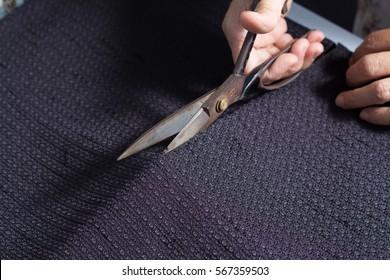 scissors cutting fabric