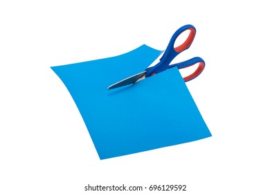 Scissors cutting a paper isolated over white