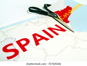 Scissors are cutting paper with the map - Catalonia separation from Spain concept,. Referendum Spain - Catalonia. Catalonia independence concept, Catalonia separation from Spain . Spanish and Catalan