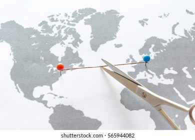 Scissors cutting union between USA and Europe. Business concept