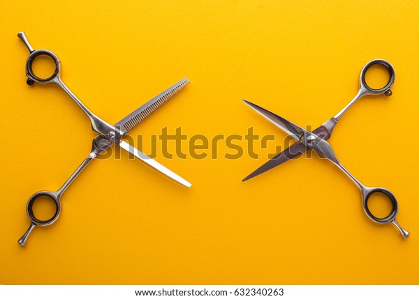 Scissors isolated on yellow background