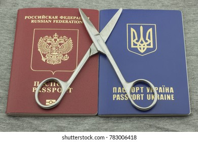 Scissors lie on the passport of Russia and Ukraine