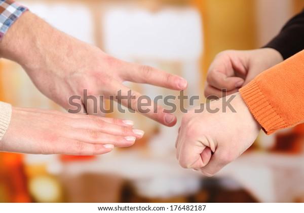 Scissors, paper, stone, scissors - hands  on light background