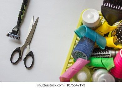 Scissors, shaving machine and waste basket in which curlers, shampoos and hair combs. Do not worry, live easier! Do not complicate things. Light background, vertical arrangement.