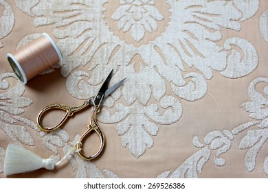 Scissors with tassel and thread