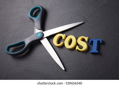 scissors with text  cost on the black background