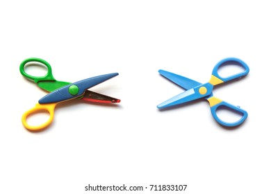 Scissors vs. Scissors on White Background