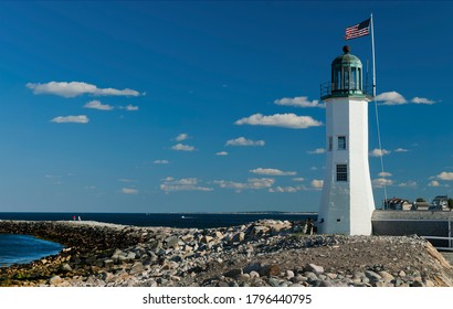 Scituate Harbor lighthouse overlooks a breakwater in Massachusetts. It is a favorite attraction and popular place to hike out on the breakwater and relax.