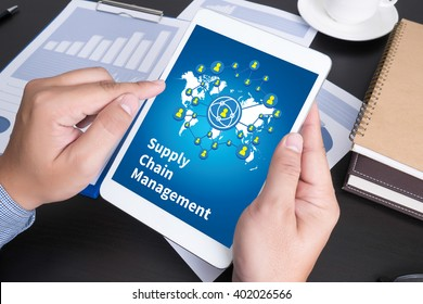 SCM Supply Chain Management concept Modern people doing business, graphs and charts being demonstrated on the screen of a touch-pad,