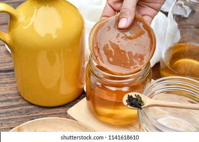 Scoby, Hand holding tea mushroom with kombucha tea, Healthy fermented food, Probiotic nutrition drink for good balance digestive system.