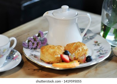 scone or scone with fruit ,whipping cream and tea