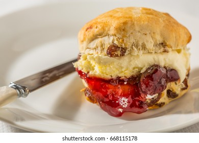 Scone on a plate with knife