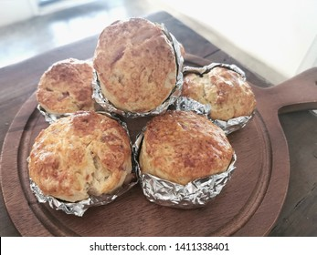 scone on wooden table. There are in bekery room.