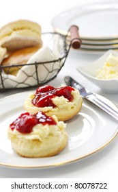 scone with strawberry jam and clotted cream , afternoon tea , cream tea , tea party, buttermilk biscuits
