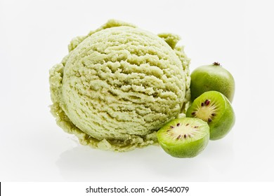 Scoop of green ice cream with fruit flavour and hardy kiwifruit in section close-up isolated on white background