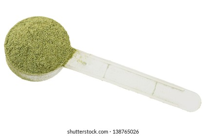 scoop of green nutritional drink powder on white background