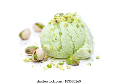 A scoop of pistachio ice cream with pistachios isolated on white background