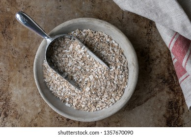 A Scoop of Rolled Rye Berries in a Bowl