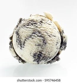 Scoop of speciality American oreo ice cream made with crumbled cookies viewed from above to show the texture over a white background