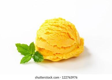Scoop of yellow ice cream isolated on white
