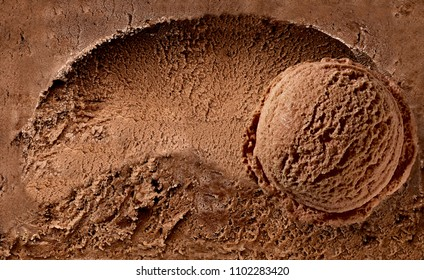 Scooped chocolate ice cream or chocolate ice cream background with scoop or ice cream ball