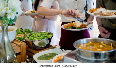 scooping the food, buffet food at restaurant.
