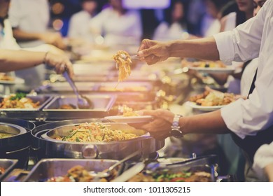 scooping the food. Buffet food at restaurant. Catering food. luxury meal