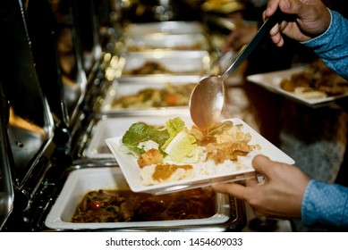 scooping the food, buffet food at restaurant, catering