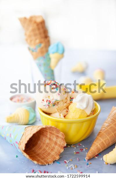 Scoops of vanilla ice cream with rainbow sprinkles