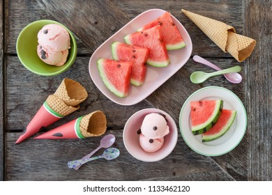 Scoops of water melon ice cream and waffle cones