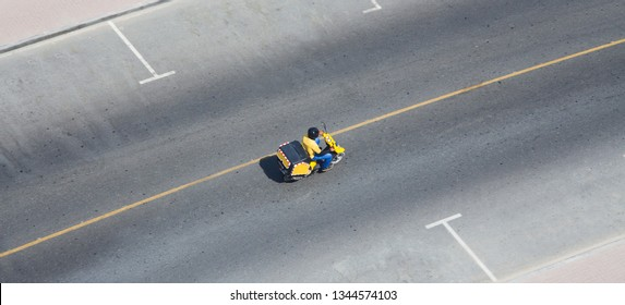 scooter delivery in asia. aerial view on street
