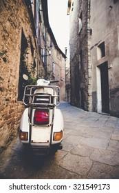 scooter in an Italian little street, color effect