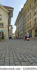 Scooter on cobble stone street in Bern