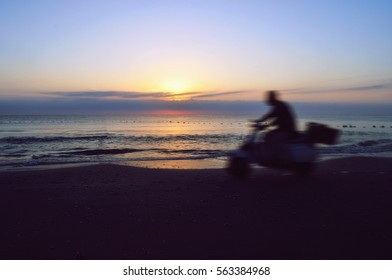 Scooter at sunset
