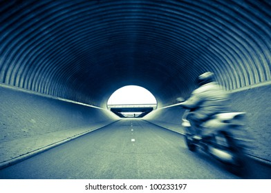 Scooter in tunnel