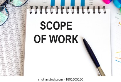 Scope of work. inscription on a white business card against the background of financial charts of a pencil and money. BUSINESS CONEPT