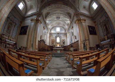 Scopello, Italy - 09/06/2017: Interior view of Parrocchia Maria Vergine Assunta church in Scopello, Northern Italy. No people are visible, shot is taken with a fish eye lens.