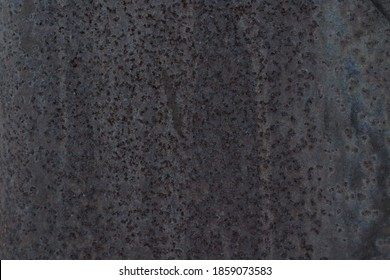 Scorched metal covered in soot texture Background close-up surface