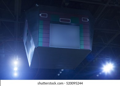 Scoreboard and spotlights in a basketball arena