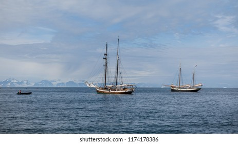 Scoresby Sound, Greenland, August 2018:  two mast sailing boats Tecla and Opal and a zodiac on the sea in arctic waters