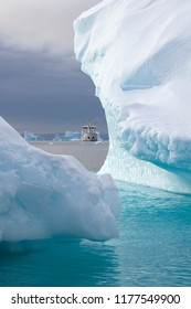 Scoresbysund. Greenland. 09.21.07. The adventure tourist icebreaker MV Grigoriy Mikheev moored amongst the icebergs of Scoresbysund in eastern Greenland.