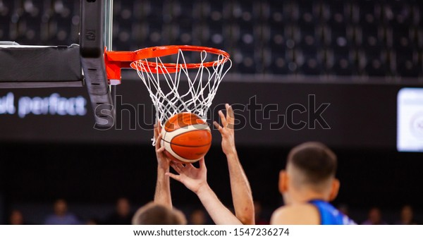 scoring during a basketball game ball in hoop