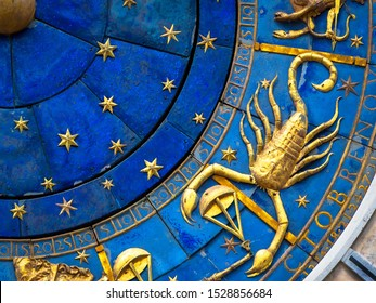 Scorpio astrological sign on ancient clock. Detail of Zodiac wheel with scorpion. Golden horoscope icon of scorpio closeup. Symbol of scorpion on star circle. Astrology concept.