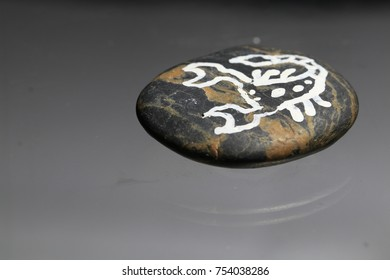 scorpion painting on stone and grey background