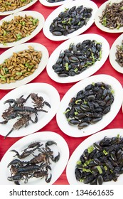Scorpions, beetles and grubs on a market food stall in Thailand