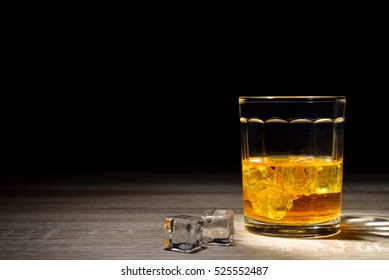 Scotch and light  on wooden background with copyspace.