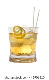 Scotch and water on the rocks with lemon peel garnish on white background