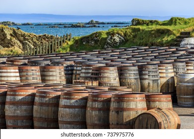 Scotch whisky barrels lined up seaside on the Island of Islay, Scotland UK