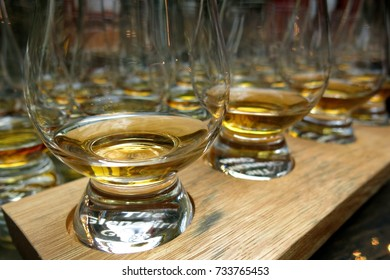 Scotch whisky tasting whiskey bourbon glasses in a row