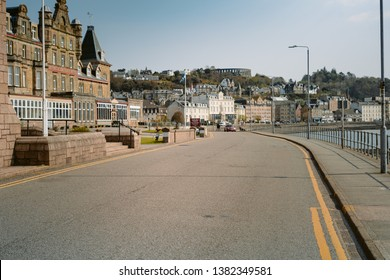 SCOTLAND, ARGYLL AND BUTE, OBAN - APRIL 12, 2019: City view of Oban with Oban Distillery and McCaig's Tower